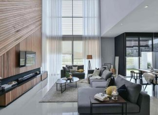 Wil's 11 Residence: living room with a double volume wood wall feature matched with sheer curtains