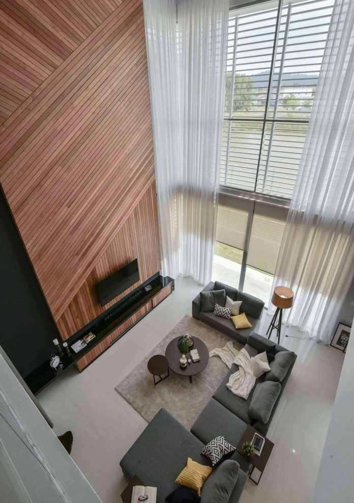 Living Room Feature Wall Design: Wil's 11 Residence: Living Room With A Double Volume Wood