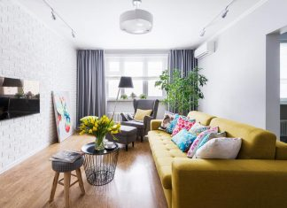Chic apartment design with a touch of different colors and materials create a warm and cozy home