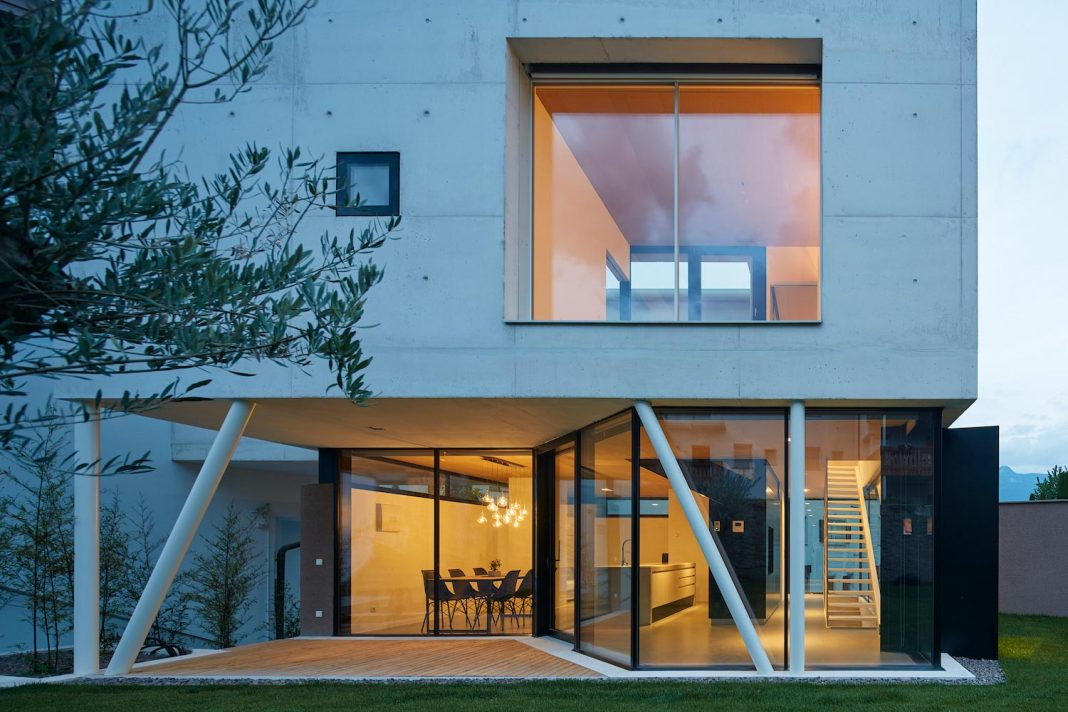 Concrete House Uses Old Walls To Create Private Patio Allowing To Add Full Glass  Walls To