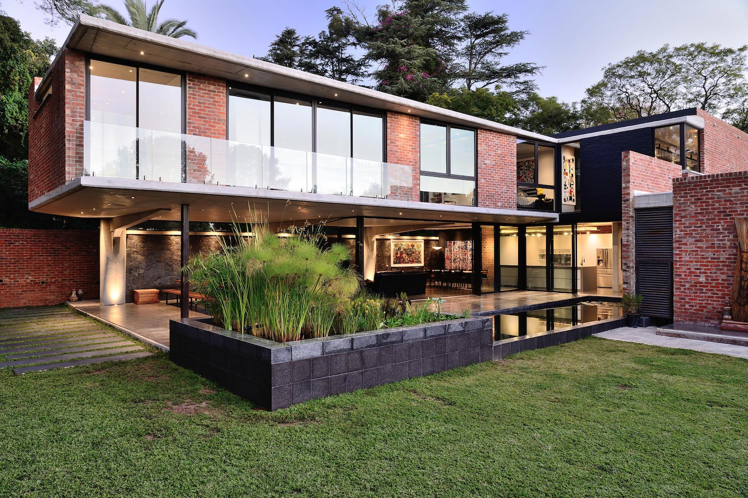 House sher by eftychis architects concrete and facebrick for Face brick home designs