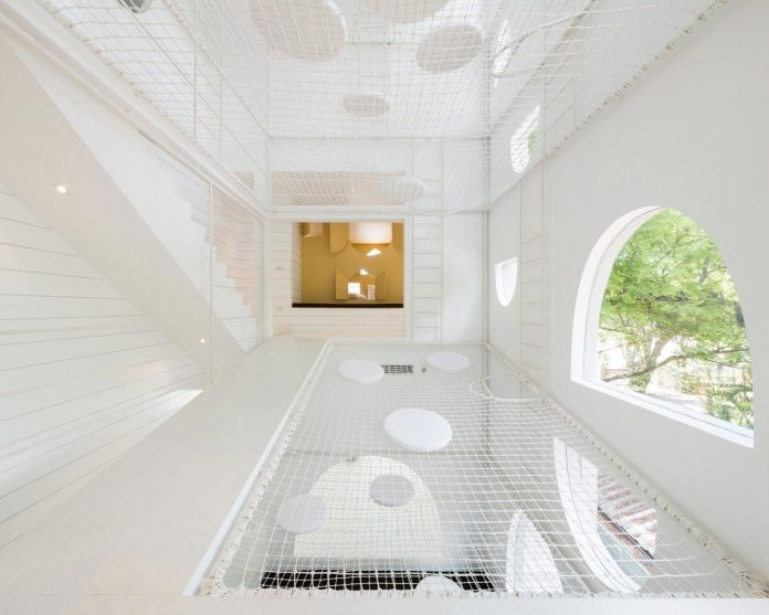 Jerry House by Onion: seaside holiday house designed to be a huge minimal playground with cool linkage of passageways