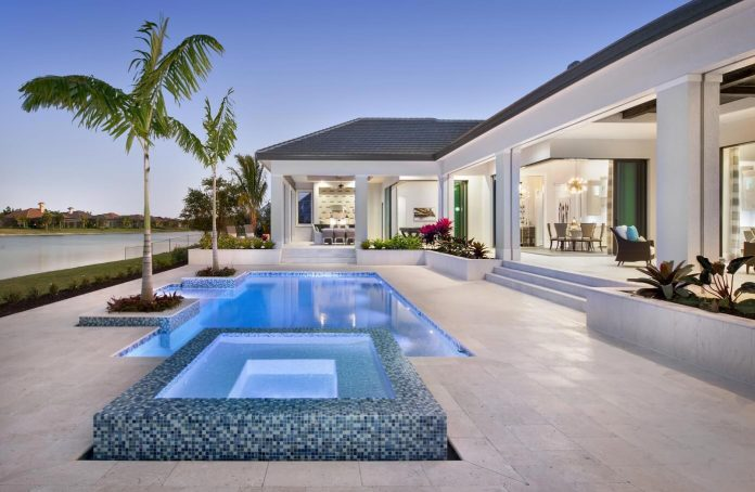 Lake-view home in Naples, Florida has smart home system interwoven throughout the entire residence