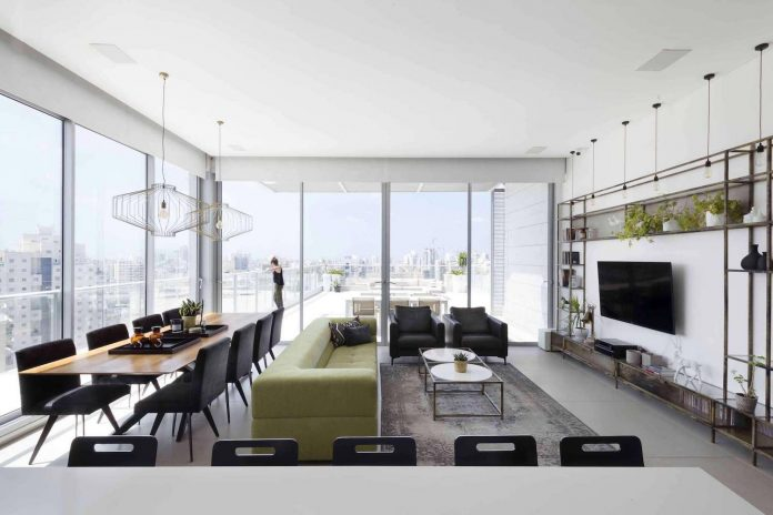 Minimalist design concept where the view remains the main focal point of this penthouse in Holon, Israel