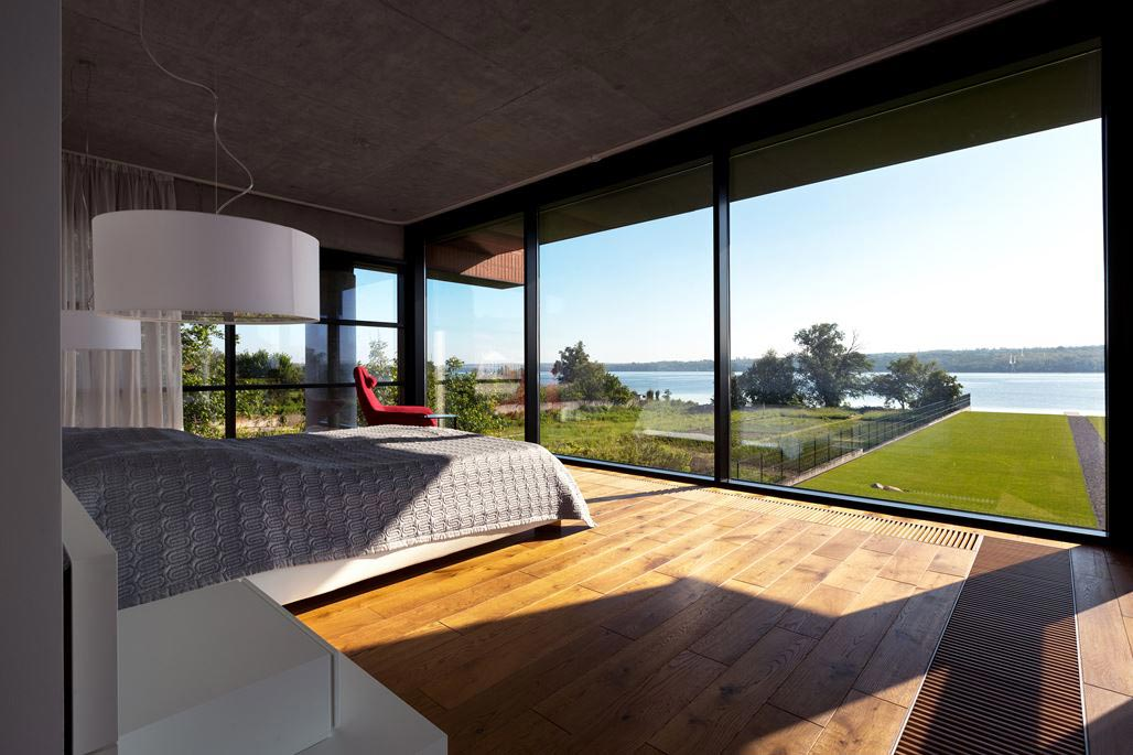 Modern brick house designed to offer spectacular lake views from all
