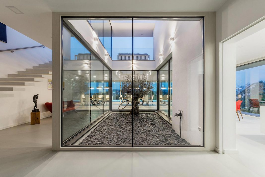 Modern two-storey villa in Budapest by Tóth Project Architect Office