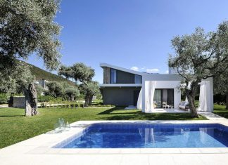 Olion Villa AA: modern L shaped residence with austere lines contrasting its organic environment