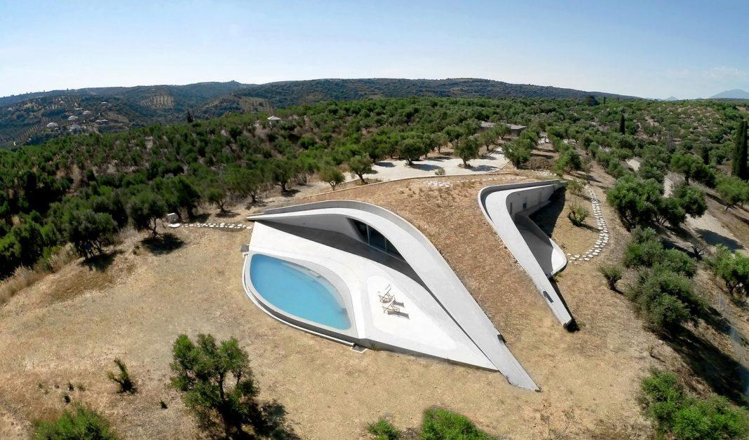 Ypsilon shaped green roof has bifurcating pathways that define three courtyards that form distinct hemispheres