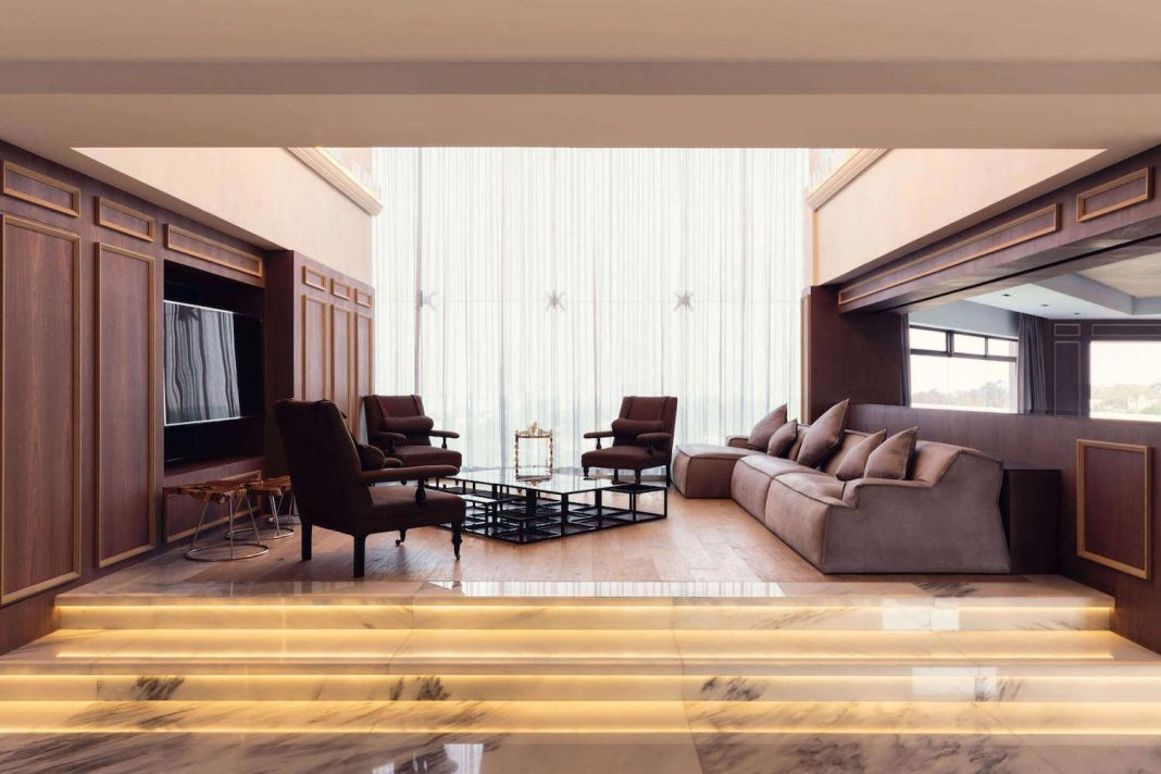 Apartment designed with both classical and modern pieces and taking full advantage of natural lighting