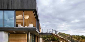 Chilmark House: redesign of old barns with low pitched roofs by Gray Organschi Architecture + Aaron Schiller