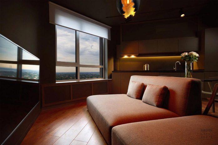 Dark apartment design with an example of minimalism in interior design