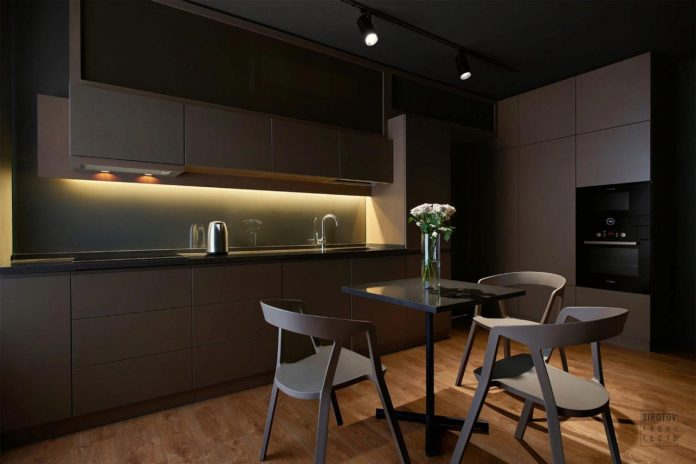 Dark apartment design with an example of minimalism in interior