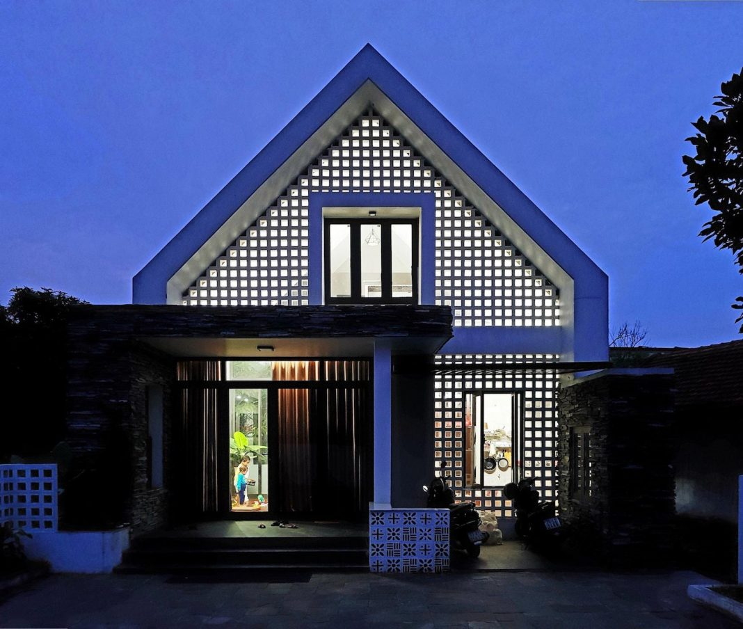 fancy design of a house using split stone, brick ventilation and