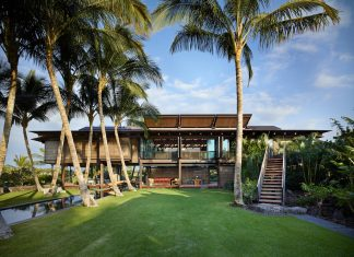 Hawaiian home set in a lush tropical landscape inspired by the architecture of the Polynesian Islands