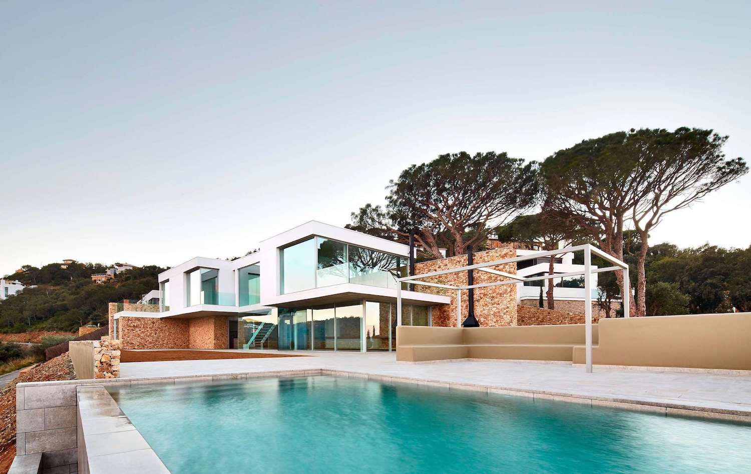 modern mediterranean house in costa brava is designed to offer