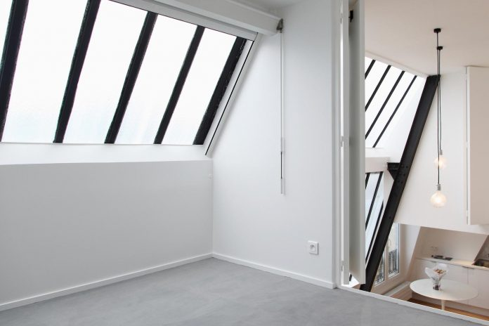 The renovation of an apartment located on the top floor of a parisian building caandesign for Balustrade mezzanine fort de france