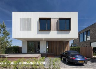 Serene exterior contrasts highly to the rough inside of this modern two-storey residence located in Amsterdam