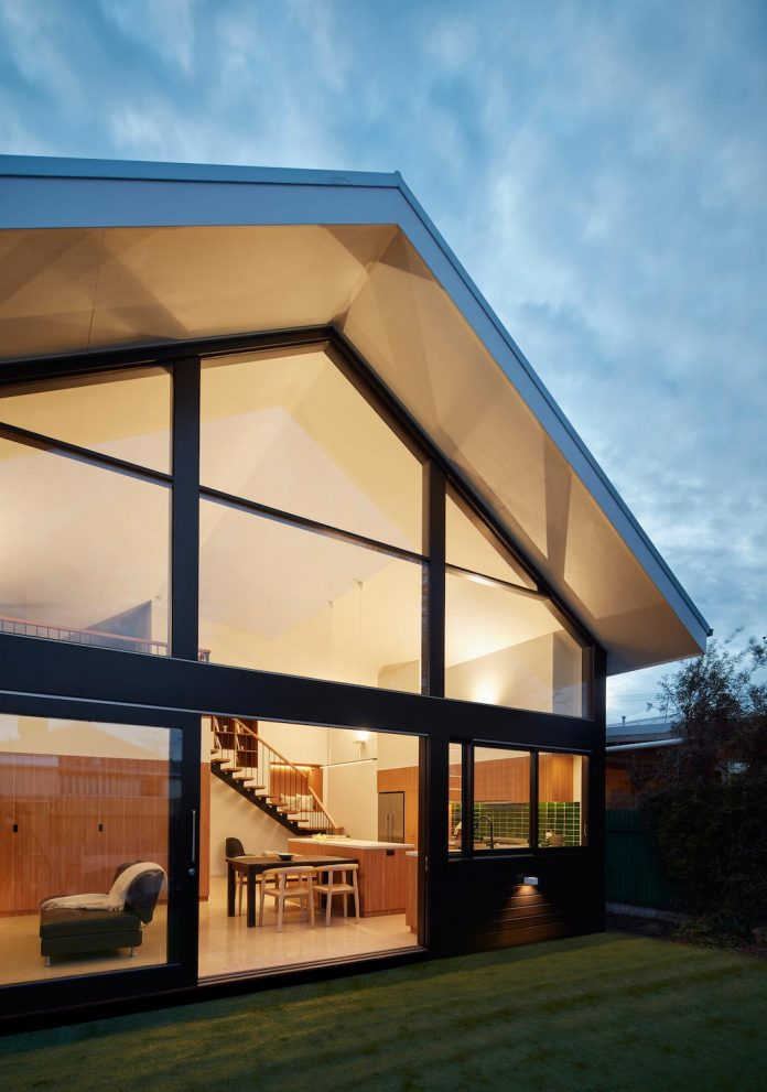 Extension of a building into a two-level, contemporary house which has a mix of private, social and work spaces