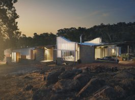 House that occupies a semi-rural block on the edge of John Forrest National Park in Australia