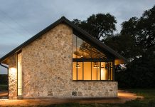 Modern barn which is the companion building to a small stone ranch house