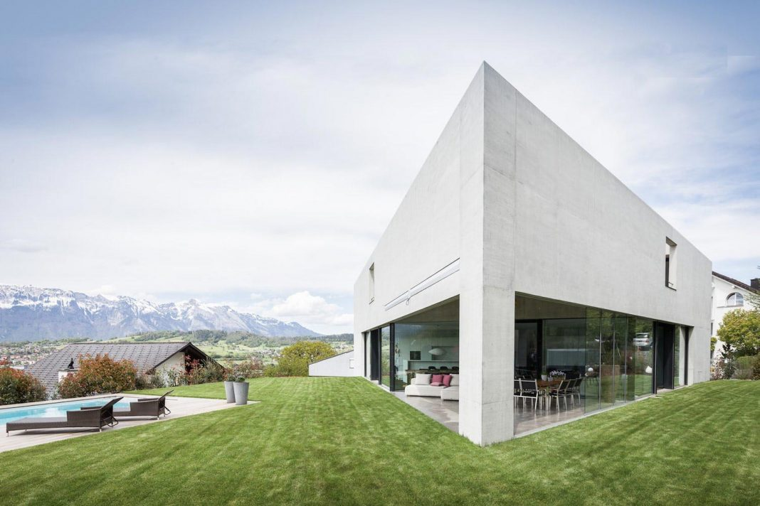Monolithic triangle structure of a house high up on the quiet edge of the forest