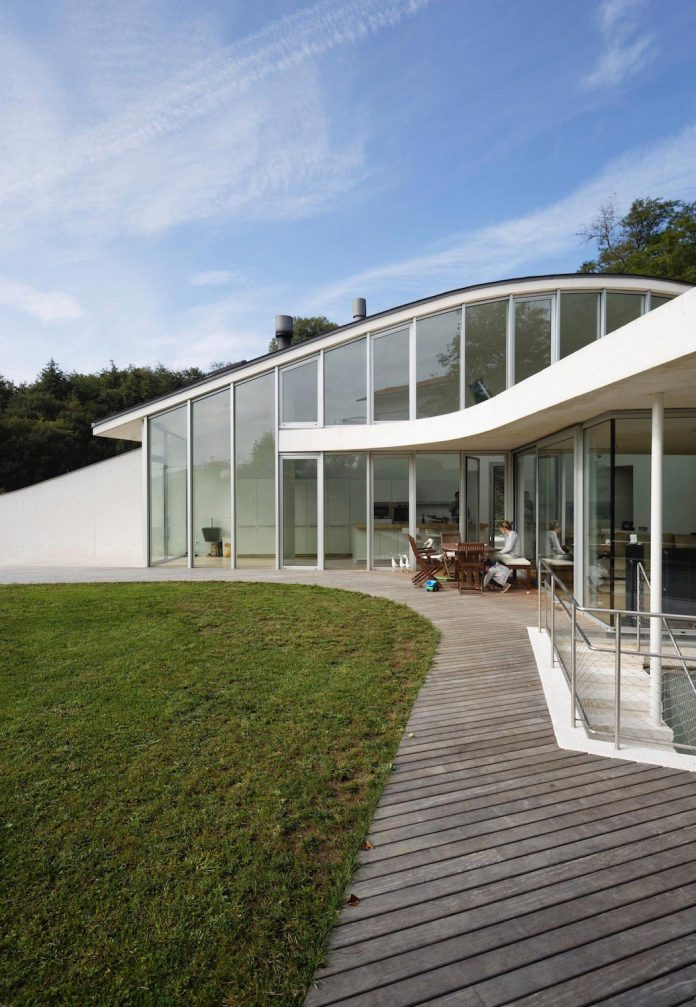 The white concrete wall that protects the house is replaced on the South  side by a glazed closure, along the living-room wing. The external  appearance of ...