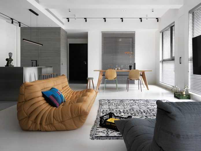 Project intended for a single-storey apartment with two main colour systems: grey and white