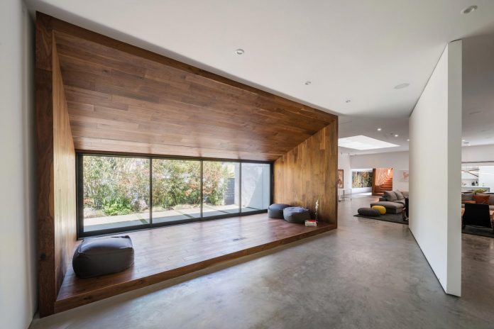 Stunning home using minimalist aesthetic, while incorporating design cues from the home's original architect by Dan Brunn Architecture
