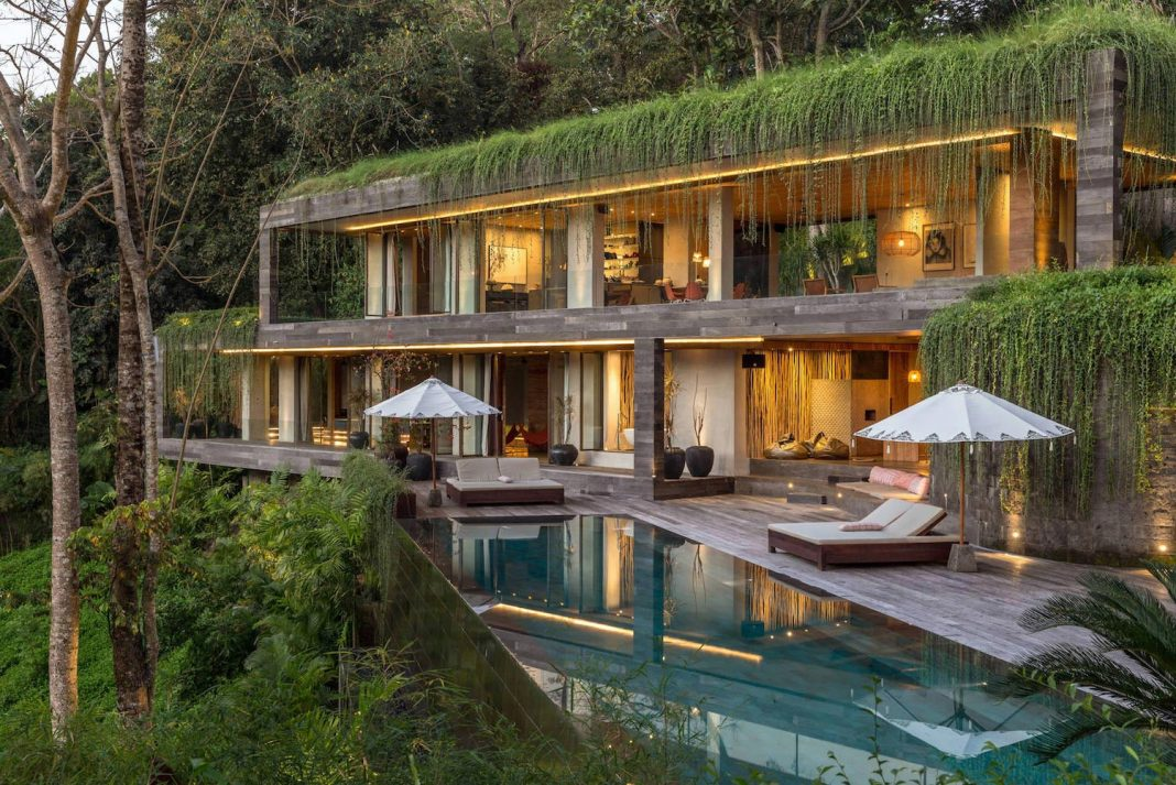 Chameleon concrete house in Singapore surrounded by greenery