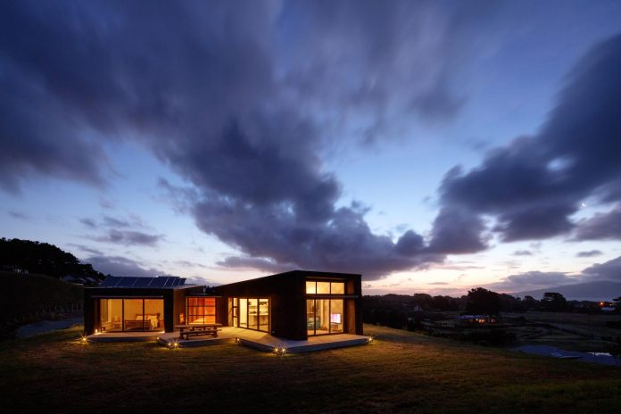 Compact house designed as a primary residence for the owners on top of a hill above Peka Peka Beach