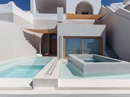 The extension of two old existing cave houses on the island of Santorini
