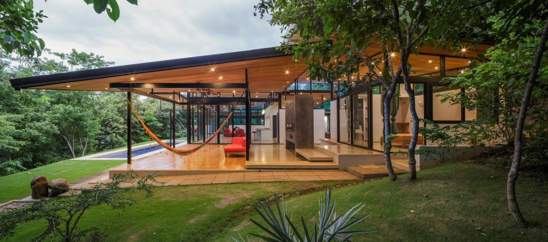House located at the edge of a touristic coastal town in Tamarindo beach surrounded by the forest