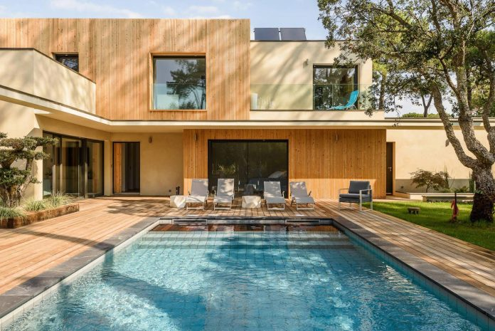 Modern wooden residence surrounded by greenery