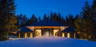 Private guest house sited at the edge of a mature forest with the interior defined by minimalist design