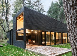 2-bedroom wooded residence quietly blends into the surrounding forest on the banks of the White River