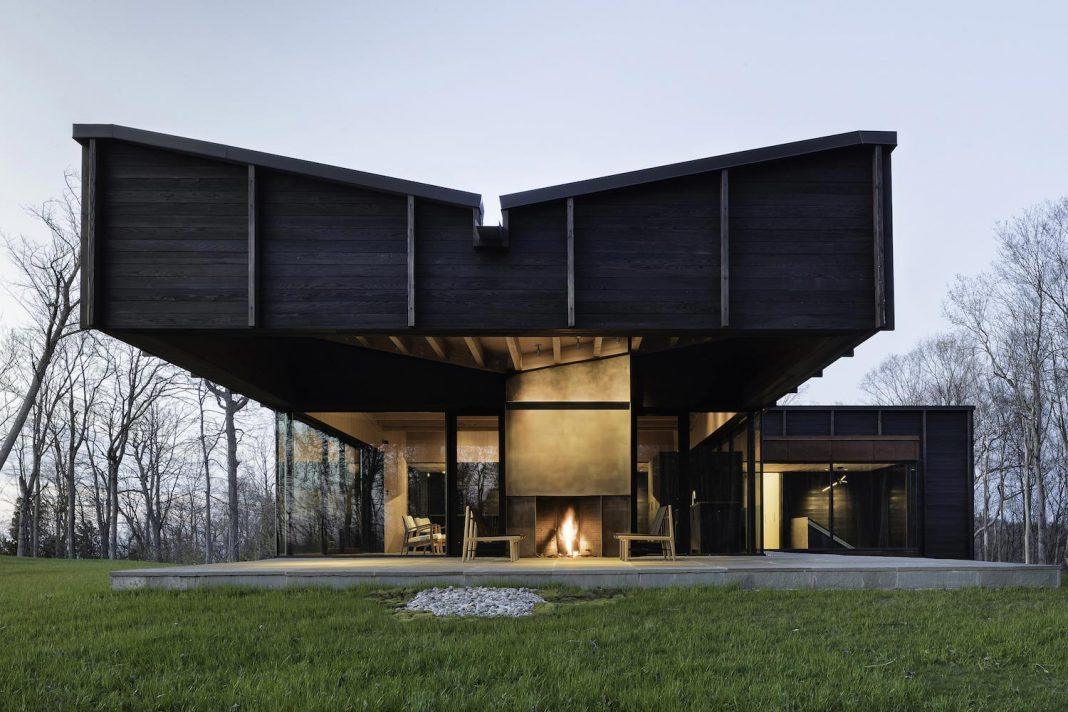 Contemporary house is an assemblage of three offset structures ...