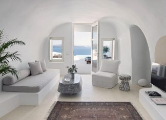 The design of a summer house totally integrated in the volcanic landscape and the cubistic architecture of Santorini