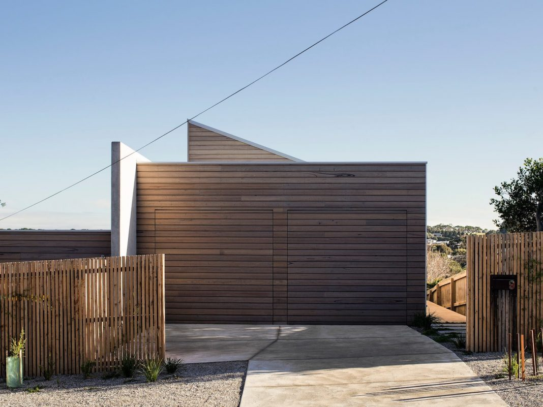 Home with understated facade that reveals little about the internal volumes one encounters upon entry