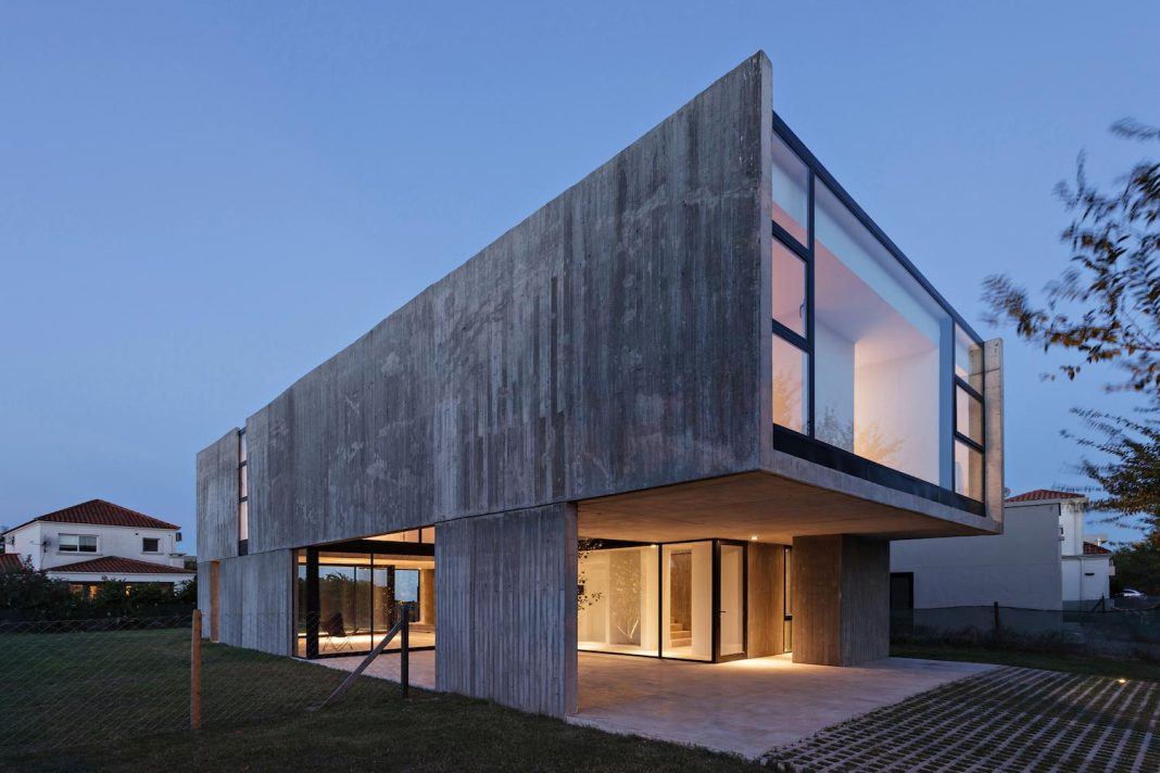 House with a distinct visual identity by placing big openings and entrances