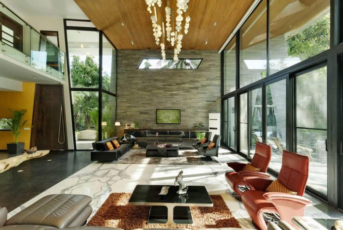 Light-filled lavish layout of expansive volumes embraces luxury with sustainability