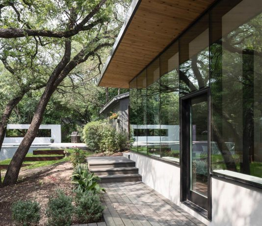 The renovation and expansion of an existing split-leve house sited on a beautifully wooded property