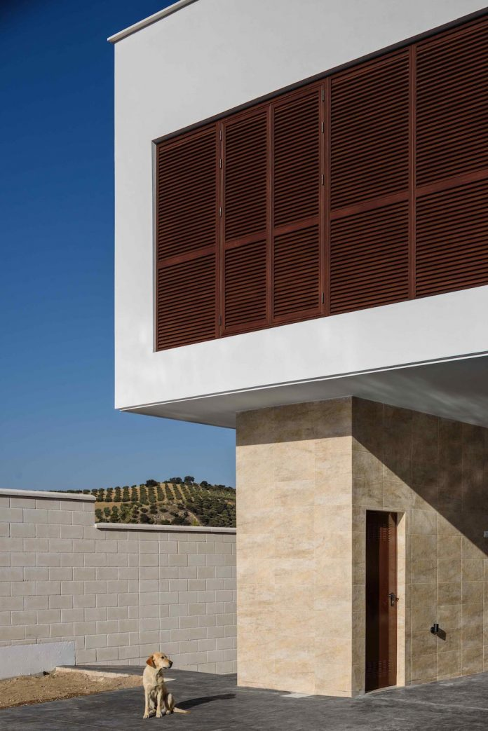 Single Family Dwelling Formed By Two Rectangular Prisms