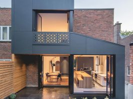 Semi-detached townhouse made of red clay brick and blond wood