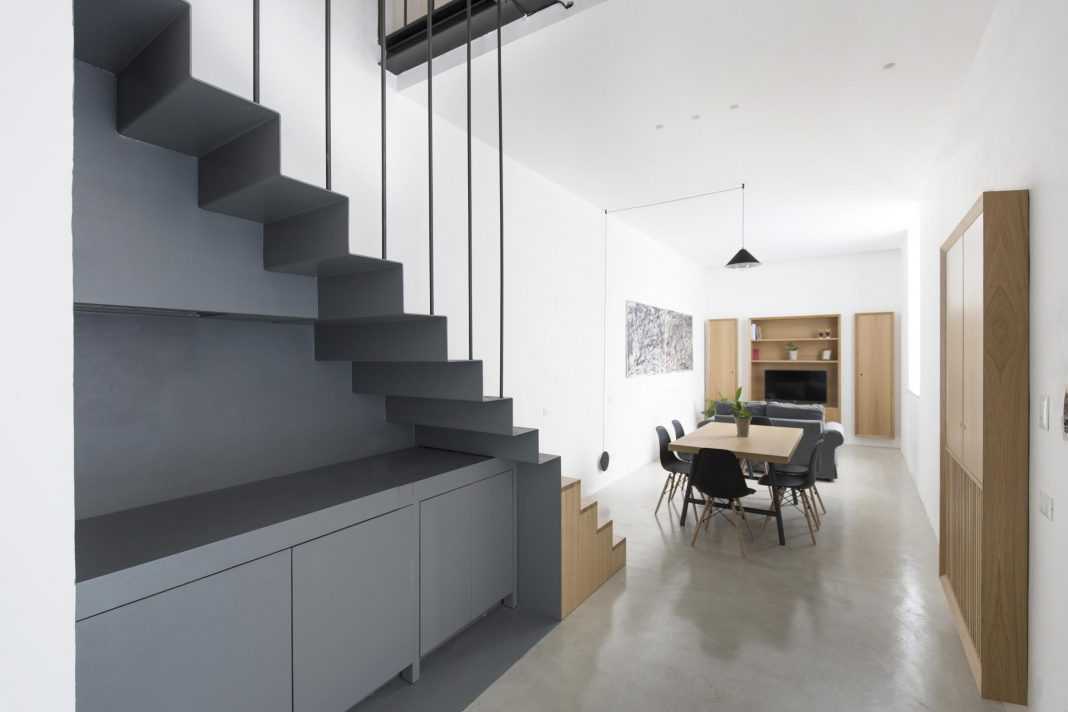 Tiny loft with clever storage and space-saving solutions featuring double-height spaces