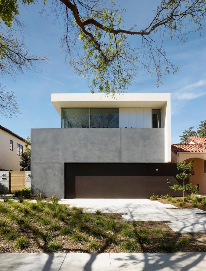Project that respects a neighborhood mainly consisting of for 1940s homes exterior design