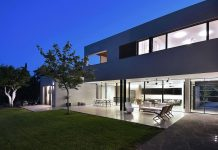 Contemporary L-shaped two-story house designed by Neuman Hayner Architects