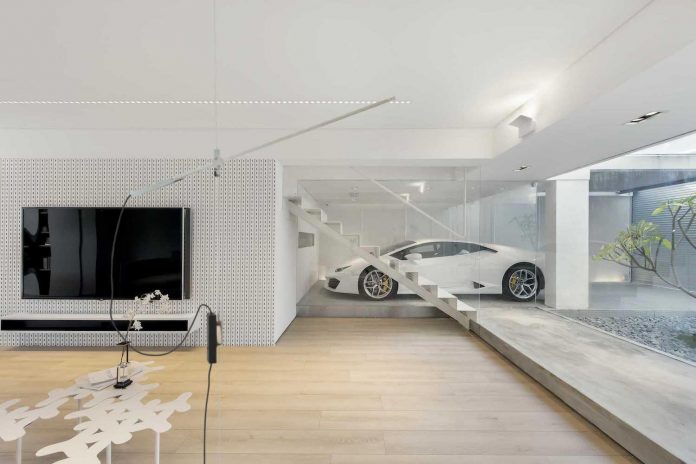 Contemporary white walls with light wooden flooring make this Hong Kong house warm and inviting