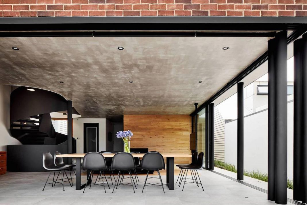 Brick, wood and black & white touches define this contemporary home ...