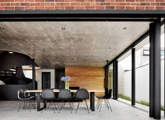 Brick, wood and black & white touches define this contemporary home by COSO Architecture