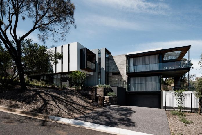 Two Angle House by Megowan Architectural is all about contrast and contemporary design